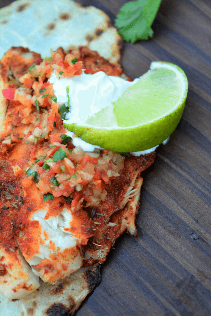 Kidney friendly smoky blackened tilapia with red pepper pico de gallo, lime, and sour cream